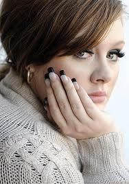 How old is Adele ?