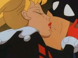 In what episode does Harley kiss Batman?