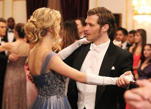 When Klaus talks to Caroline, which city does he mention besides Rome and Tokyo?