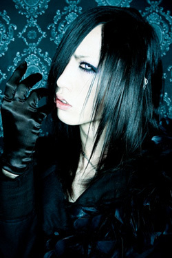 Tsuzuku was known as what in his previous band?