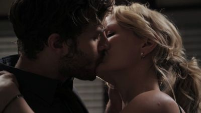 Who initiates their kiss in this scene, Emma or Graham?