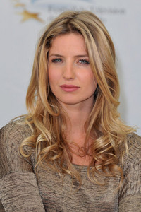 Annabelle Wallis was brought up in which country?