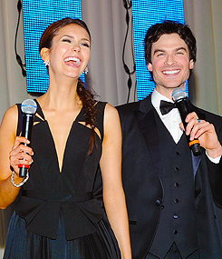 What did Nina and Ian action for $80,000 at Elton John's Oscars Party to raise money for charity?