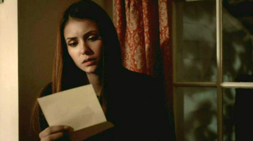 Who leaves an apology letter for Elena and tells her that 'her compassion is a gift' in this scene?
