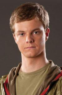 In the Hunger Games Movie, who does this person play?