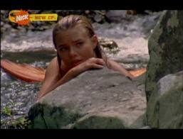In Jungle Hunt, how does Bella turn into a mermaid?