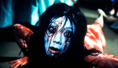 In the horror film, The Grudge (2004), which characters did Kayako's husband, Takeo brutally kill?
