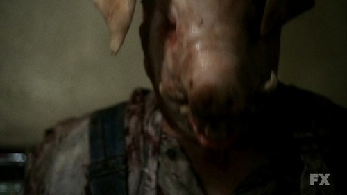 movie references / A butcher puts a pig's head on his head as a gruesome mask and then goes off to murder people.