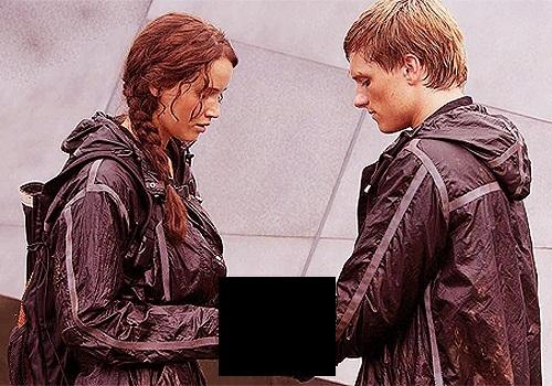 What was Katniss handing Peeta in this image?