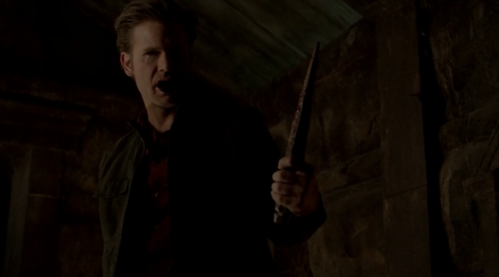who turned alaric into a vampire hunting vampire ?