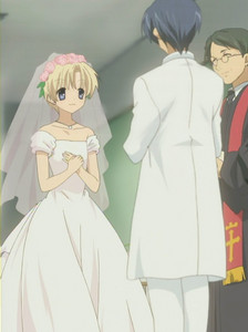 Who is wearing the wedding dress in THIS picture?