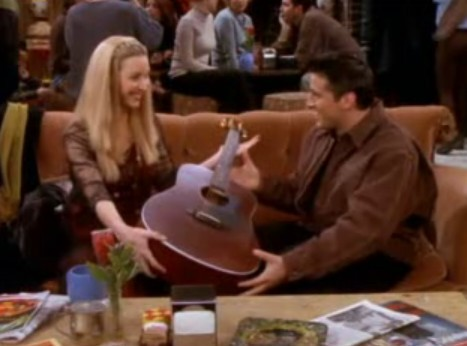 T/F Phoebe is left handed, but when she plays the guitar, she plays it with her right hand?