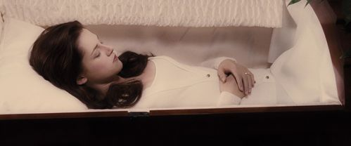Who is looking at Bella in her coffin?