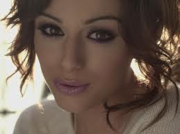 Which member of One Direction did Cher kiss?