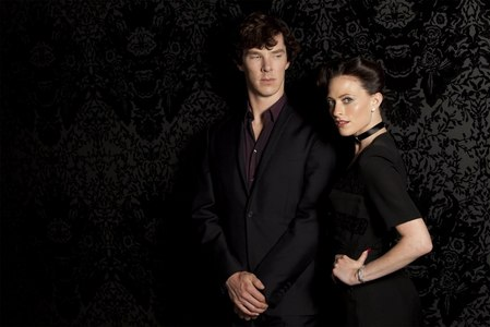 Who is standing next to Sherlock?