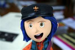 What type of hat does Coraline wear in the movie?