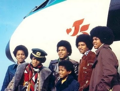 Who arranged for the Jackson 5 to audition for the label?