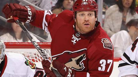 Who did Coyotes forward Raffi Torres (#37) illegally hit in the head to earn his 25 game suspension?