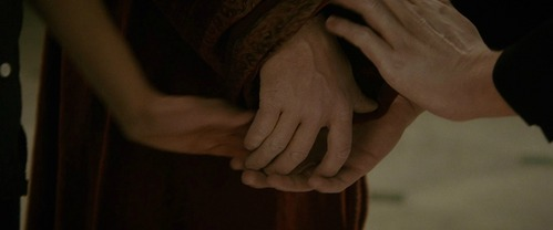 Who pulls Edward's hand away from Bella's?
