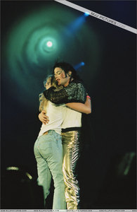 In which Songs brought Michael one lucky Girl with him on Stage?