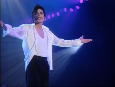 In which Song appeared a Woman dressed like an Angel with Michael on Stage?
