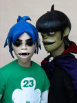 What song is playing when 2D & Murdoc are answering tanong when they were in New York?