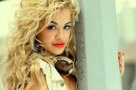 who was rita ora signed by