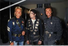 Who are these two men with Michael Jackson