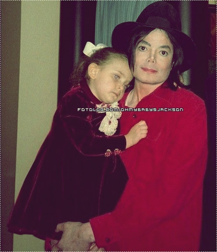 Who is this cute little girl in Michael's arms