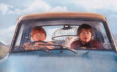 In the movie, what is the license plate of Mr.Weasley's flying car?