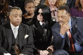 Who is this man with Reverend Al Sharpton and Michael Jackson