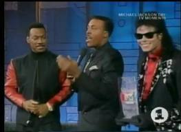 Who is this man with Eddie Murphy and Michael Jackson