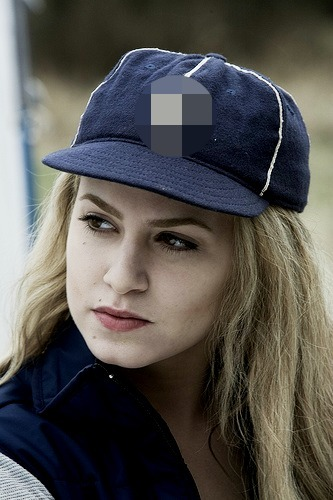 What letter is on Rosalie's baseball cap?