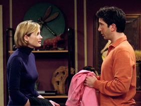 In TOW The چائے Leaves, Ross finds Mona's key and goes into her flat to find his 'salmon' coloured sweat shirt. What is the colour of the sofa he hides behind??
