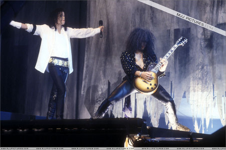 Who is this musician in the photograph with Michael Jackson