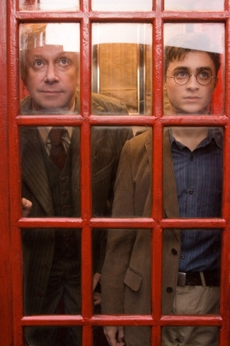 What was the code that Mr. Weasley typed into the visitors' entrance to the Ministry?