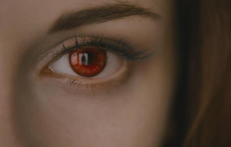 Why does Bella have red eyes?