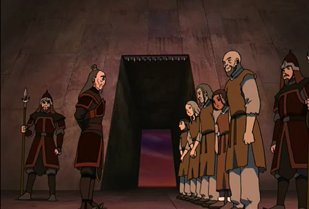 Besides Haru what's the difference between Katara and the other prisoner's uniform ?