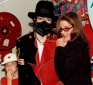 Who is this little girl in the photograph with Michael and Lisa Marie Presley