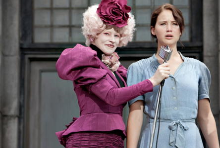 In the reaping who's old dress did katniss wear??