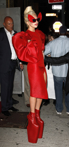 Gaga shows off a little meer than she'd hoped in a red crotch revealing outfit.