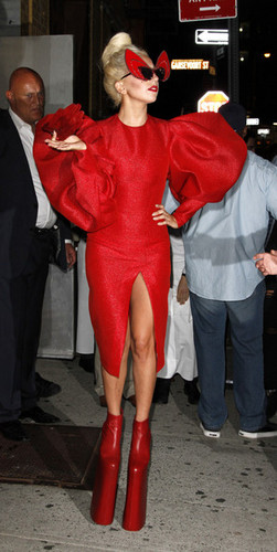Gaga shows off a little più than she'd hoped in a red crotch revealing outfit.