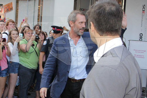 Hugh Laurie waves to fan during the Toronto International Film Festival 2011