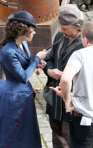 "Rachel McAdams and Robert Downey Jr on the set of ""Sherlock Holmes 2"" (September 22)."
