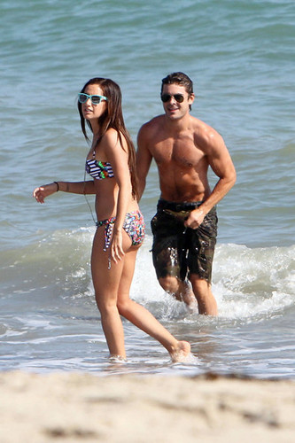 Ashley and Zac kissing and huging on the beach, july 2