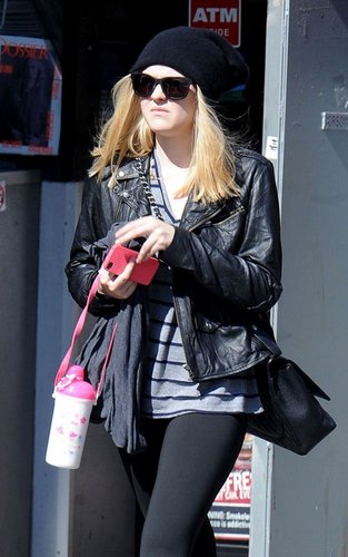 Dakota Fanning out and about in NYC (October 5).