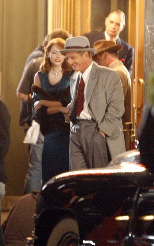 "Emma Stone and Sean Penn on the set of ""Gangster Squad"" (November 2)."