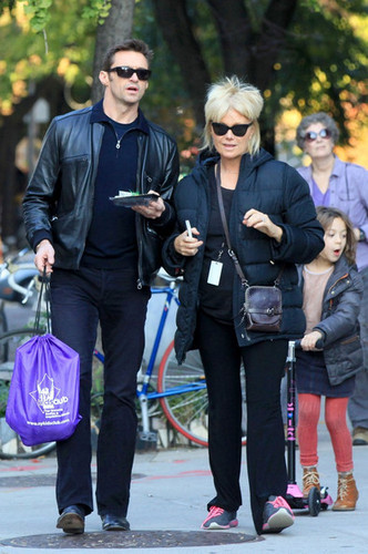 Hugh Jackman walks with his wife and daughter