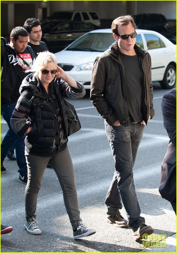 Amy Poehler & Will Arnett Land at LAX