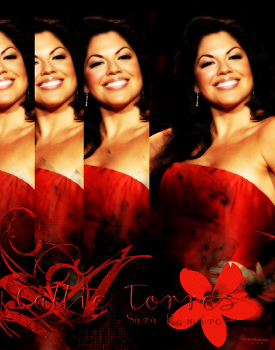 Callie Torres/Sara Ramirez in red dress